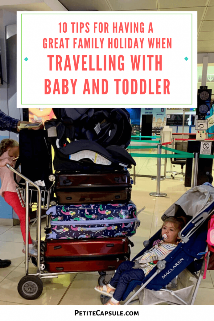 Laden suitcase cart with toddler, and baby in a stroller