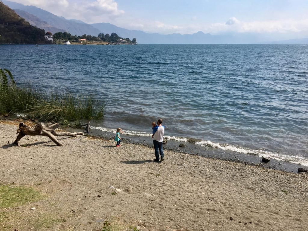 Kids on the beach with dad.