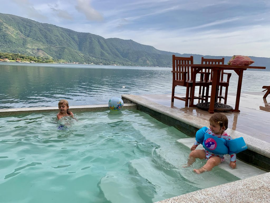 Kids in a pool with infinity edge