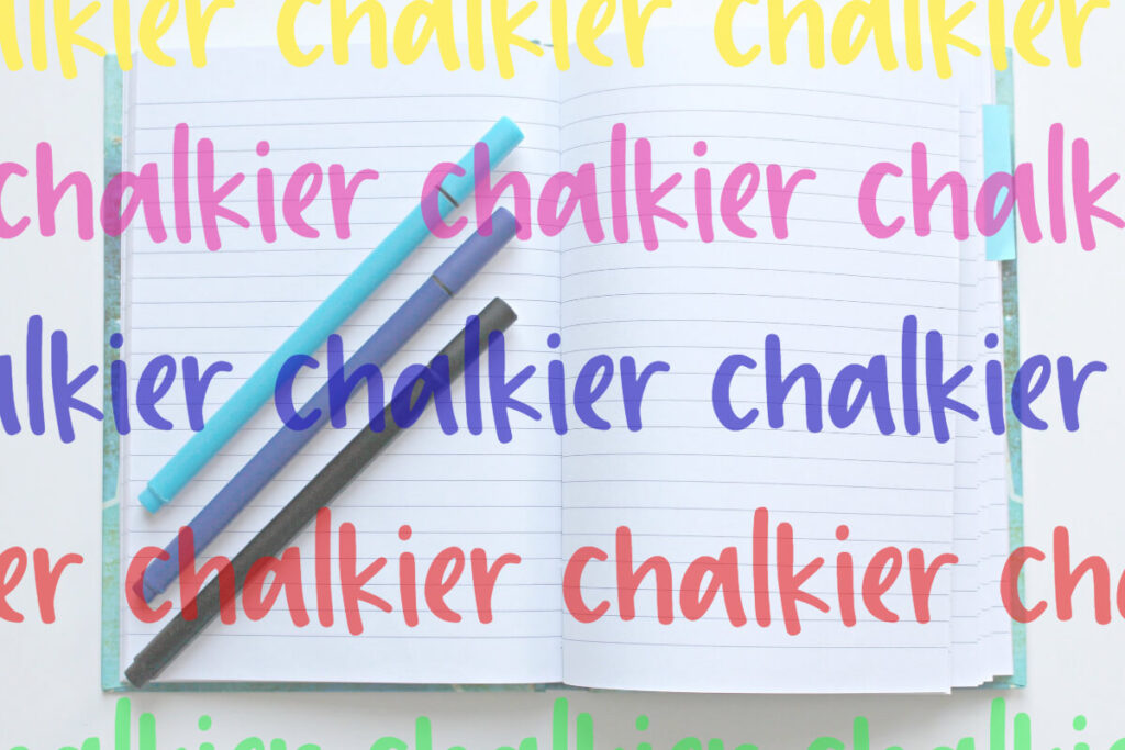"Chalkier handwritten font used to repeat the word ""chalkier"" across an image of a notebook and 3 blue pins."