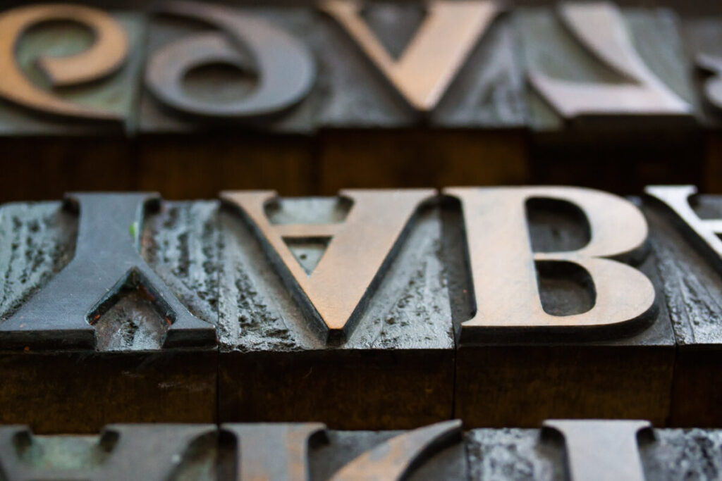 Example of a serif font. Metal letters of Y, A and B are upside down.